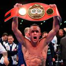 Champion: Josh Warrington holds aloft IBF featherweight belt after battle with Lee Selby