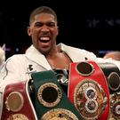 Anthony Joshua holds the WBA, IBF, WBO and IBO heavyweight belts (PA)