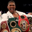Anthony Joshua holds four belts (Nick Potts/PA)