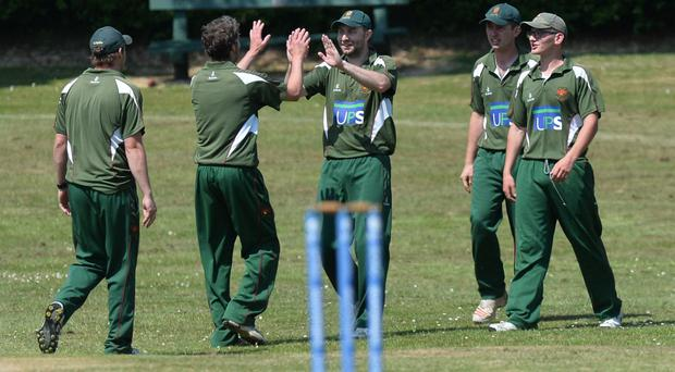 Well taken: Downpatrick celebrate after Danny Carson catches CIYMS's Ryan Hunter during Saturday's match at Strangford Road