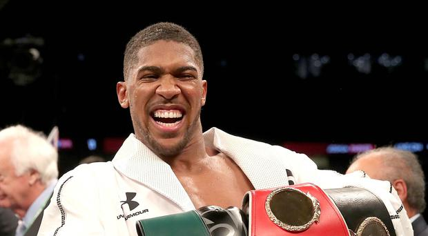 Anthony Joshua has signed a three-year extension to his deal with promoters Matchroom (Nick Potts/PA Images)