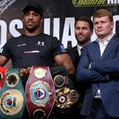 Anthony Joshua, left, defends his heavyweight titles against Alexander Povetkin at Wembley this weekend (Tim Goode/PA)