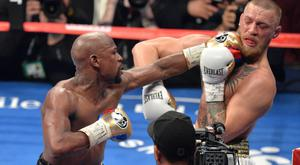 Floyd Mayweather (left) defeated Conor McGregor in August last year (PA)