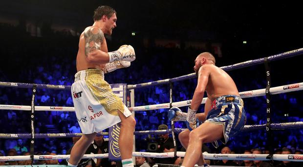 Oleksandr Usyk (left) knocked out Tony Bellew at the Manchester Arena (Nick Potts/PA)