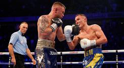 Josh Warrington (right) defeated Carl Frampton at Manchester Arena to defend his featherweight title (Martin Rickett/PA).