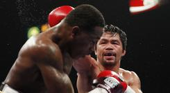 Manny Pacquiao (right) in action against Adrien Broner (John Locher/AP)