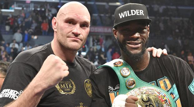 Tyson Fury, left, and Deontay Wilder, right, fought to a draw in December (Lionel Hahn/PA)