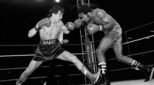 Eusebio Pedroza, right, surrendered his world title to Barry McGuigan in 1985 (PA)