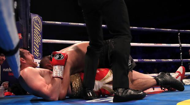 Kash Ali, face obscured, has had his boxing licence suspended by the BBBC (Peter Byrne/PA)