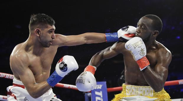Amir Khan was beaten by Terence Crawford on a sixth round TKO (Frank Franklin II/AP)