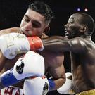 Amir Khan was stopped in the sixth round by Terence Crawford (Frank Franklin II/AP)