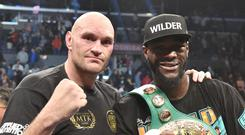 Deontay Wilder, right, and Tyson Fury drew their fight in December (Lionel Hahn/PA).