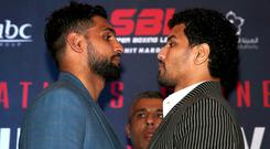 Amir Khan (left) and Neeraj Goyat pose during the head to head during the press conference at The Landmark Hotel, London. (Steve Paston/PA)