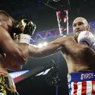 Tyson Fury defeats Tom Schwarz in their heavyweight bout in Las Vegas (John Locher/AP)