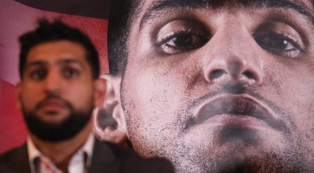 Amir Khan won the vacant belt (Isabel Infantes/PA)