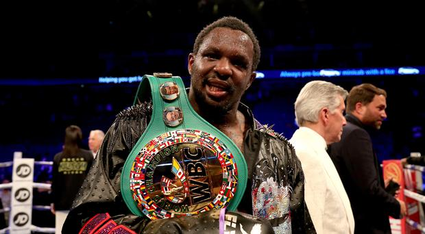 Dillian Whyte celebrates victory after defeating Oscar Rivas in London (Bradley Collyer/PA)