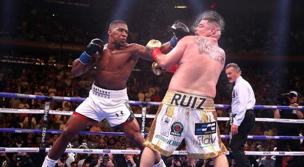 Anthony Joshua (left) and Andy Ruiz Jr will fight in Saudi Arabia in December (PA)
