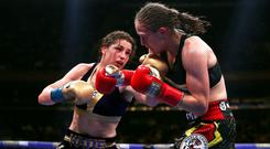 Katie Taylor (left) became undisputed lightweight champion with victory over Delfine Persoon in June (Nick Potts/PA)