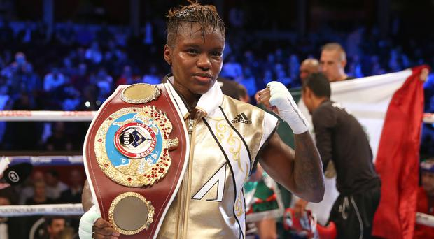 Nicola Adams poses with the belt after retaining her WBO flyweight title (Steven Paston/PA).