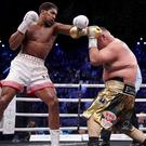 Anthony Joshua (left) regained his titles (Nick Potts/PA)