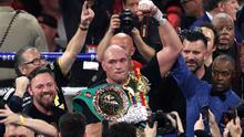 Tyson Fury (centre) clinched the WBC world heavyweight title (Bradley Collyer/PA)