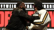 Deontay Wilder and Tyson Fury were involved in a shoving match at their press conference (Bradley Collyer/PA)
