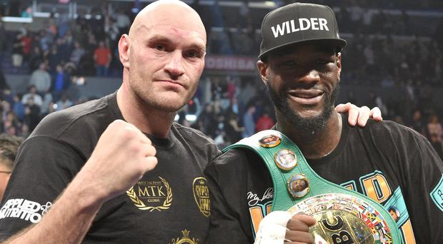 Tyson Fury and Deontay Wilder's rematch is set to go ahead on February 22 (Lionel Hahn/PA)
