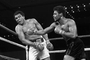 Leon Spinks connects with a right hook to Muhammad Ali during the late rounds of their championship fight in Las Vegas (AP)