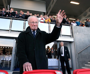 Local hero: Jack Kyle gets a standing ovation during a visit to Ravenhill last February. He was always a popular visitor to the stadium he once graced as a player