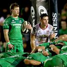 Direct battle: Connacht's Kieran Marmion and John Cooney of Ulster