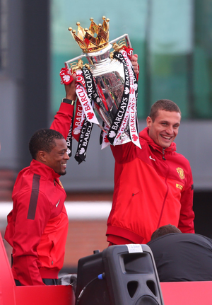 Real deal: Patrice Evra and Nemanja Vidic won numerous medals with Manchester United, despite struggling at the start of their Old Trafford careers
