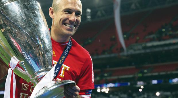 LONDON, ENGLAND - MAY 25: Arjen Robben of Bayern Muenchen celebrates with the trophy after victory in the UEFA Champions League final match between Borussia Dortmund and FC Bayern Muenchen at Wembley Stadium on May 25, 2013 in London, United Kingdom. (Photo by Alex Grimm/Getty Images)
