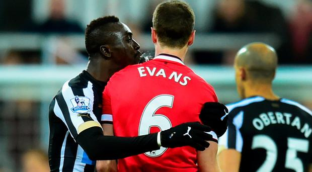 Caught on camera: Newcastle United's Papiss Cisse is pictured spitting at Jonny Evans
