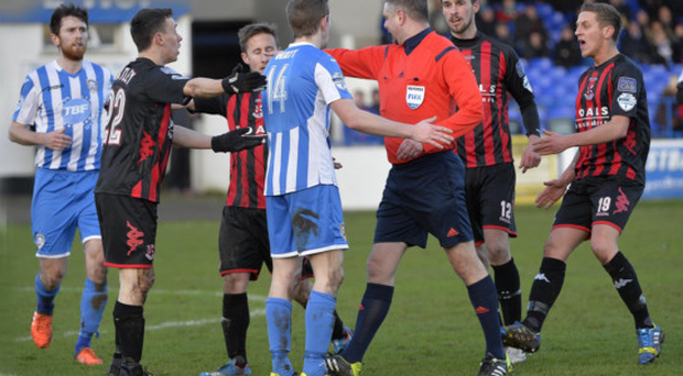 Inside or outside? Raymond Crangle points to the spot after Johnny Watt's foul on Paul Heatley