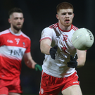 Behind you: Tyrone's Cathal McShane and Ryan Dougan of Derry