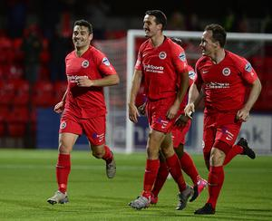 Deadly Davy: Davy McDaid (left) is all smiles as he celebrates his first goal against Linfield on Tuesday night
