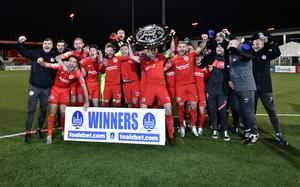 Big prize: Larne celebrate as they get their hands on the biggest trophy in local football