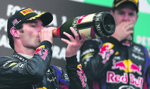Sebastien Vettel wonders if Mark Webber will carry out his offer to share his bottle of champagne with him