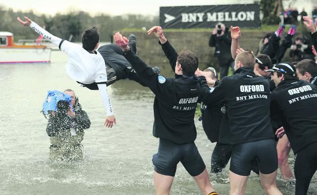 The Oxford University's cox Oskar Zorrilla is thrown into the Thames by his team mates as they celebrate winning the 159th Boat Race on the River Thames, London