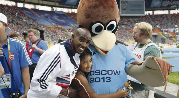 MOSCOW, RUSSIA - AUGUST 10: Gold medalist Mo Farah of Great Britain poses with with daughter Rhianna Farah and the games mascot during the medal ceremony for the Men's 10000 metresduring Day One of the 14th IAAF World Athletics Championships Moscow 2013 at Luzhniki Stadium on August 10, 2013 in Moscow, Russia. (Photo by Christian Petersen/Getty Images)