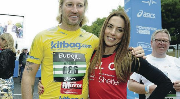 Robbie Savage pictured with Mel C from the Spice Girls after they completed the Great North Run