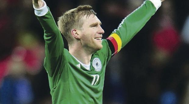 Per Mertesacker of Germany celebrates his team's 1-0 victory during the international friendly match between England and Germany at Wembley Stadium