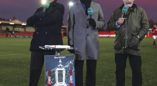 ITV presenter Adrian Chiles (L) alongside Clarke Carlisle (C) and Martin Allen (R) during the FA Cup Second Round match between Tamworth and Bristol City at The Lamb Ground on December 8, 2013 in Tamworth, England