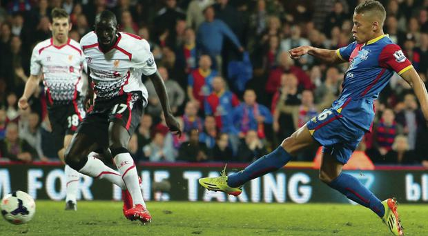 Blown it: Dwight Gayle fires home the equalising goal against Liverpool, much to the delight of his mum, Crystal