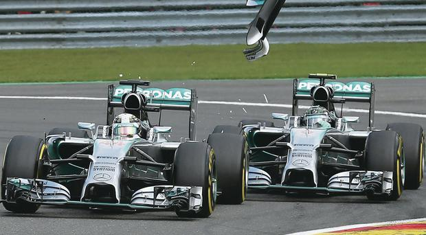 Nico claims bonus: Lewis Hamilton and Nico Rosberg come to blows in the playground at Spa
