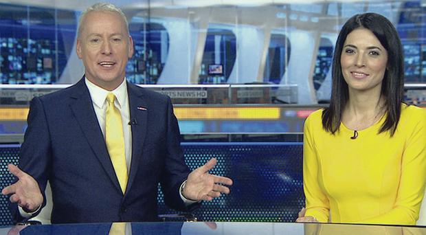 All yellow: Jim White in full flow as Natalie Sawyer thinks of a reason not to apologise for something