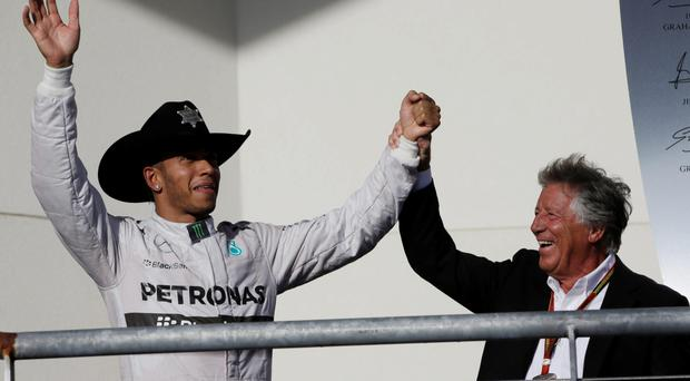 Hat's magic: He's one of the world's fastest men but Lewis Hamilton can be made to look a fool at the drop of a hat