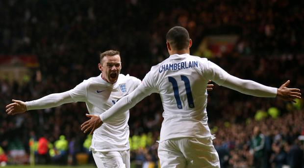 Glasgow hug: there's only one Wayne Rooney... or two if you can't see it's Alex Oxlade-Chamberlain