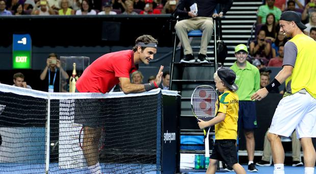 Little smasher: Is it any wonder Roger Federer has won 1000 games when he's up against these easy opponents. The wee lad should put up a better fight though