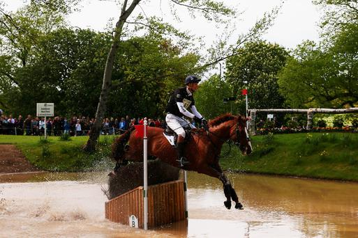 Jump to it: William Fox-Pitt clears the world's biggest shaving brush during the Badminton Horse Trials